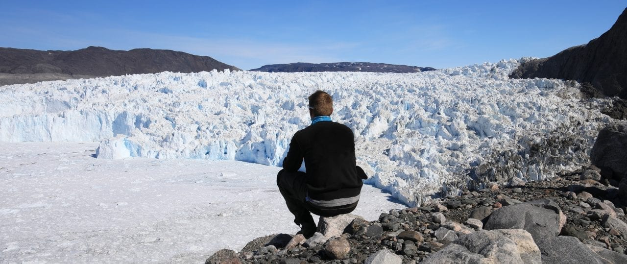 A guide enjoying the view of the Eqi Glacier
