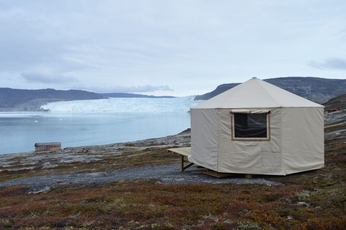 Wilderness tents with a great view of the calving glacier in the bagground - Photographer: Mads Asbjoern Klausen