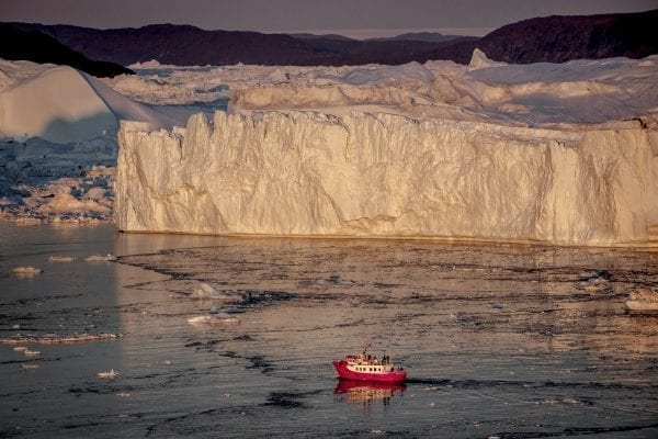 A Passenger Boat In The Sunset Near The Icebergs Of Ilulissat Ice Fjord In Greenland - Photo by Air Zafari - Mads Pihl - Visit Greenland