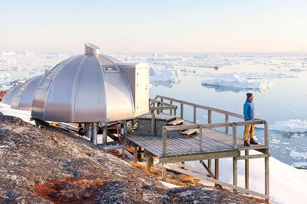 A Traveler Enjoying The View From The Igloo Viewpoint At Hotel Arctic Near The Ice Fjord In Ilulissat